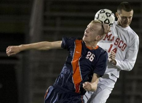 Walpole's Chris Gallivan (left) and Masconomet's Justin D'Orlando battle for a ball.